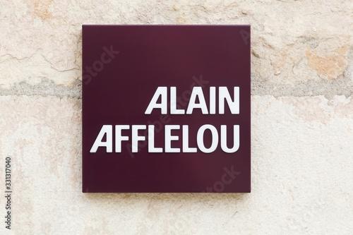 Villefranche, France - September 22, 2019: Alain Afflelou logo on a wall Wallpaper Mural