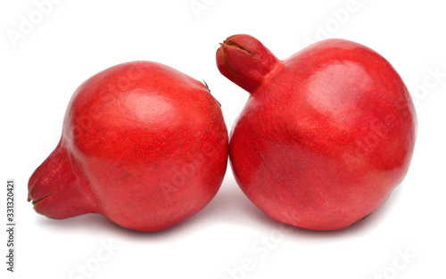 Fotografie, Obraz Two whole pomegranate fruit isolated on a white background