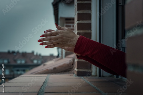 a woman's hands with red nails sticking out the window to clap Wallpaper Mural
