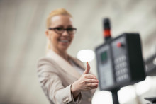 Businesswoman Showing Thumbs U...