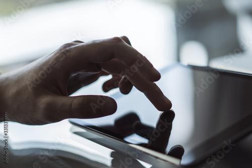 Vászonkép Male finger clicks on a digital tablet, business and technology concept