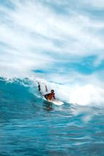 Girl Surfer Paddling In The Oc...