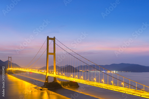 Fototapeta modern suspension bridge in nightfall
