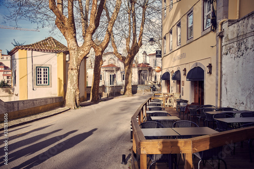 Sintra / Portugal - March 02 2020: Street view with a caffe terrace in the downt фототапет