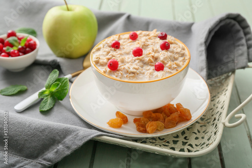 fototapeta na drzwi i meble Bowl with tasty sweet oatmeal on tray