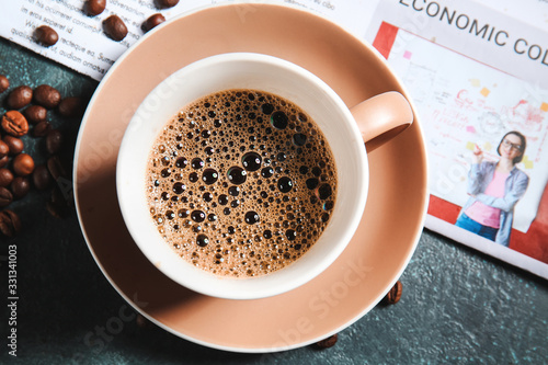Fototapeta Cup of hot coffee and newspaper on table obraz