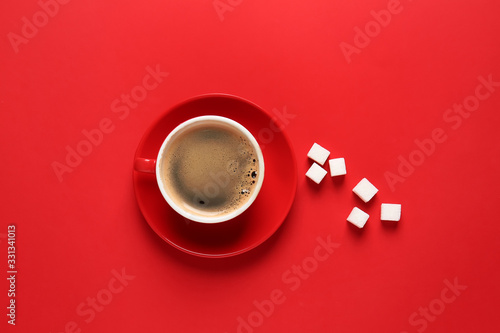 Fototapeta Cup of hot coffee and sugar on color background obraz