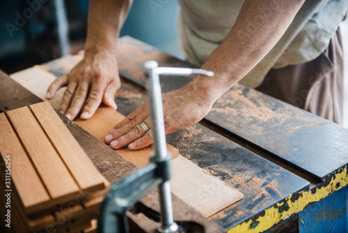 man woodworking in a shop - 331356256