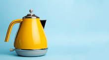 Kettle Background. Electric Vintage Retro Kettle On A Colored Blue Background. Lifestyle And Design Concept