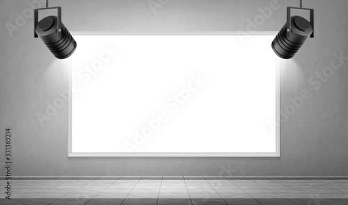 Fotografie, Obraz Empty white frame and hanging spotlights in museum or gallery hall