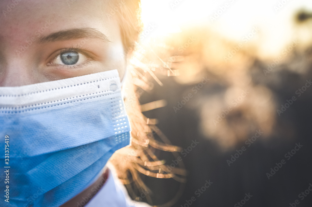 Fototapeta Woman wearing protective mask against coronavirus. Put mask to fight against Corona virus. COVID-19 SARS, SARS-CoV, virus 2020 chinese virus 2019-nCoV
