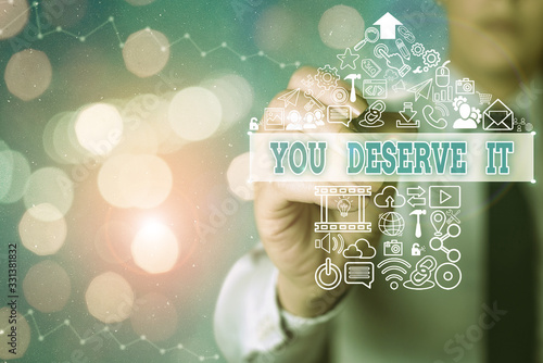 Conceptual hand writing showing You Deserve It Wallpaper Mural