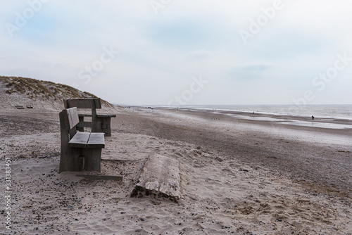 Fototapeta The beach at Henne Strand in Denmark with benches in the foreground