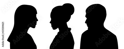 Fotografiet Head silhouettes of three people. Black and white.