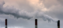 Air Pollution From Smoke Coming From Three Factory Chimneys.