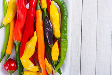 Chili Pepper Selection On White Wood Table Background