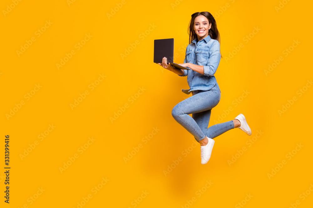 Fototapeta Full length profile photo of funny business lady jump high up hold notebook hands addicted worker always online wear casual denim outfit white sneakers isolated yellow color background - obraz na płótnie
