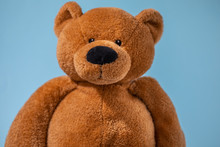 Teddy Bear Isolated On Blue Ba...