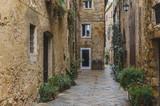 Fototapeta Uliczki - Walk on a rainy day through the streets of the beautiful town, Pienza, Tuscany