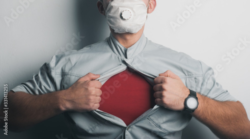 Photo Superhero in a medical mask, a symbol of protection from covid-19,