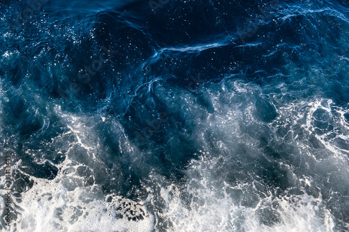 Plakaty do łazienki  top-down-aerial-view-of-sea-water-surface-white-foam-waves-texture-as-natural-background