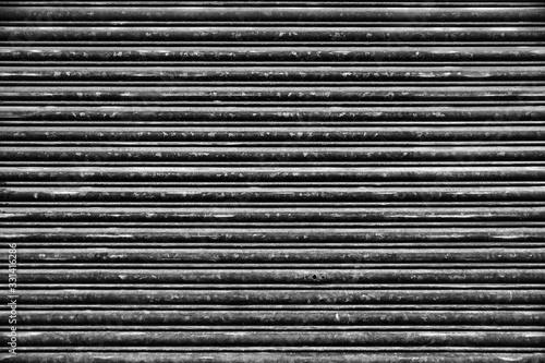 Old Roll-up Garage Gate. Old rusty garage doors. Fototapeta