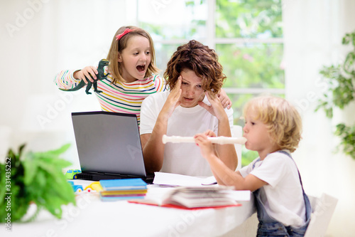 Mother working from home with kids. Quarantine. - 331435252