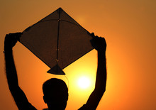 Silhouette Of Man With Kite In...