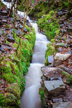A Narrow Stepped Rocky Waterfa...