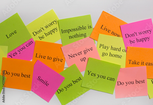 Motivational words on colorful stickers on white background Canvas Print