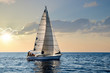 canvas print picture - close-up sailboat sailing under a beautiful sunset