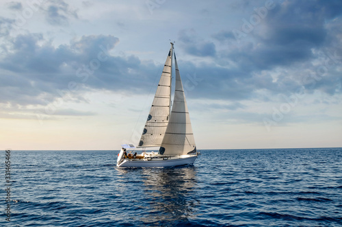 close-up sailboat sailing under a beautiful sunset