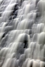 Slow Shutter Speed Close Up Image Of Water Overflowing Down The Wall Of The Derwent Dam Derbyshire