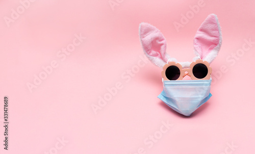 easter bunny in protective medical masks quarantine concept for easter holiday due to epidemic Wallpaper Mural