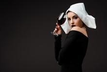 Beautiful Sexy Nun Holding Gla...