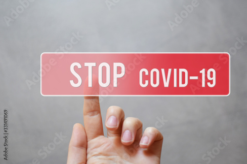 Stop covid 19 - finger pressing red transparent button on virtual touchscreen interface on gray background with copy space for text Canvas Print