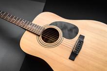 Acoustic Guitar On Black Backg...