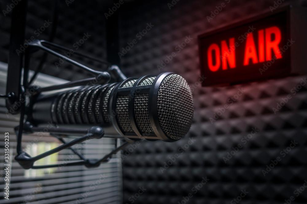 Fototapeta Professional microphone in radio station studio on air