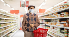 Senior Man Shopping In A Supermarket With A Medical Face Mask On