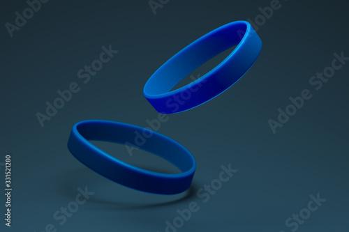Fotomural Blue Rubber Bracelets on Dark Blue Background