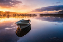Boat On Still Lake At Sunrise,...