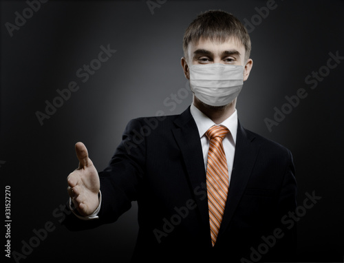 Photo businessman man in medical mask reach out hand for handshake