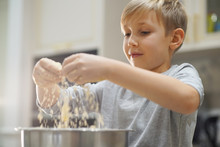 Child Cooking At The Kitchen. ...