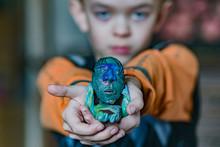 A Little Boy Shows A Craft Made Of Plasticine
