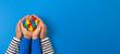 Leinwandbild Motiv World autism awareness day concept. Adult and child hands holding puzzle heart on light blue background