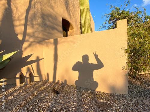 adobe man shadow peace sign Canvas Print