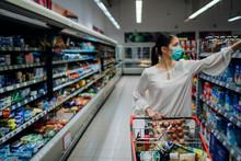Woman With Hygienic Mask Shopp...