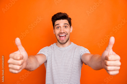 Closeup photo of crazy funny guy open mouth good news raise thumb fingers up app Wallpaper Mural