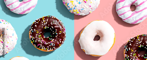 Fotografija Collection of delicious donuts overhead view flat lay