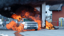 Pickup Truck And Snowmobile On Fire At Gas Station